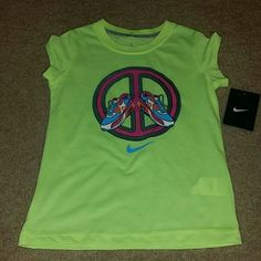 Nike girls (youth) shirt sz 6 NWT New with tag, polyester.  Little girls size 6.  Please check my other listings.   Thank you for looking and have a great day! Nike Tops