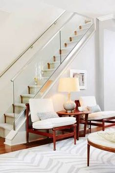 Love how they made this narrow old staircase look larger and modern!