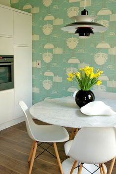 Sixties wallpaper. On an accent wall in the living room was a kitchy wallpaper in a fun color. The pattern was faded but unmistakably 1960s. (midcentury kitchen Kitchen)