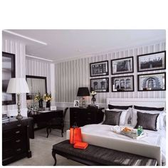 i like the contrast between the white headboard and black accent pieces.