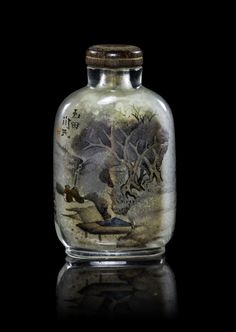 A Chinese Interior Painted Glass Snuff Bottle, of compressed flask form depicting figures in a wooded landscape, signed with a seal.  Height 2 3/8 inches.