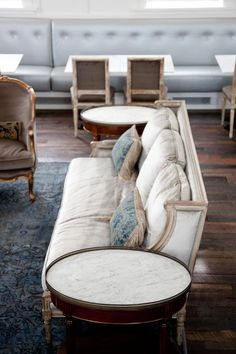 Love the vintage French furniture with the contemporary leather banquette seating.