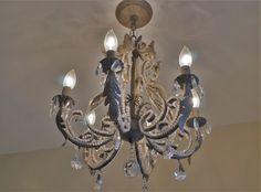 Restoration Hardware chandelier in Anne Cutler's New Orleans master bath