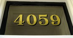 Gold leaf address on glass. Photo from New Bohemia Signs