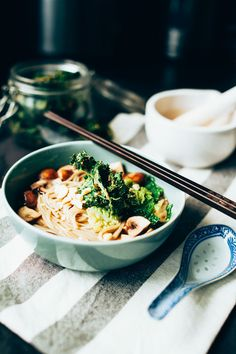 asian inspired broth with noodles, mushrooms and savoy cabbage