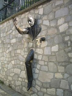 Paris - Montmartre - 'Le Passe-Muraille', the man who could pass through the walls, Place Marcel-Aymé, Paris 18 (crossroads of 'rue d'Orchampt', 'avenue Junot', 'rue Girardon' and 'rue Norvins')