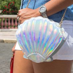 In case you missed it, here you go  Hologram Shell Purse - Super CUTE!