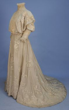 TRAINED SILK HIGH NECK GOWN with EMBROIDERY, 1890's.