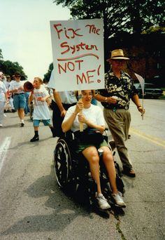 "For many activists, the fight for the rights of people with disabilities centers on changing the attitudes of society and removing barriers, not ""fixing"" the person with a disability."