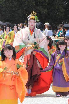 Women and girls dressed in junihitoe.