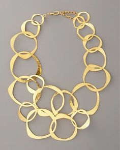 """Inspiration: Circle-Link Bib Necklace by Herve Van Der Straeten at Bergdorf Goodman.This striking Herve Van Der Straeten necklace, constructed of graduating, irregular 24-karat yellow gold-plated links, will complement both your complexion and your ensemble's color palette.  24-karat yellow gold-plated brass shapes irregular, open-link necklace.  Hammered finish.  Hook closure with chain extender.  Adjusts from approximately 15""""-21""""L.  Made in France."""