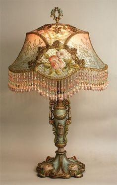 This is a French lamp in the Art Nouveau style from around the century. The floral embroidery featured on the exterior of the lampshade combined with the hand-painted lamp base creates a complex and interesting piece of lighting. Victorian Home Decor, Victorian Lamps, Victorian Furniture, Antique Lamps, Vintage Lamps, Vintage Lighting, Vintage Decor, Victorian Parlor, Vintage Globe