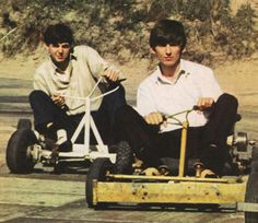 Paul McCartney & George Harrison at the Weston-super-mare in Somerset, photographed by Dezo Hoffman; c. July 1963
