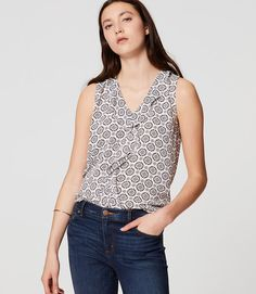 I like the pattern, the neckline, and the subtle ruffle on this top.