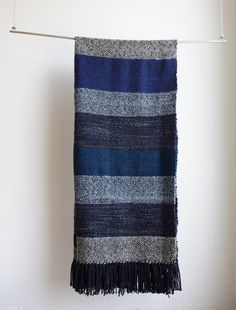 This blue and grey mexico serape blanket style is made of 100% merino wool hand dyed getting a super soft touch in striped colors of navy blue,