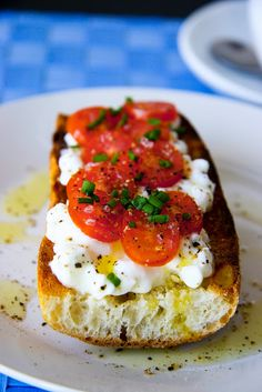 Cottage cheese and tomato on baguette Toast the baguette. Spread some cottage cheese on top. Top it with slices of the cherry tomatoes. Sprinkle with chives. Season with salt and black pepper.