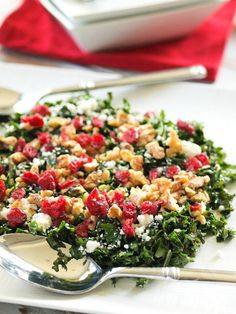 This Chopped Kale Salad with Cranberries, Feta, and Walnuts is a  quick and easy light side dish to pair with any CPK oven-ready pizza.