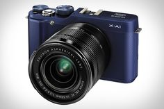 FUJIFILM X-A1 ~ compact, lightweight body and a 16-50mm F/3.5-5.6 lens. The camera comes in an attractive retro design, available in three colors, black, blue and red. It also boasts the sort of feature set you'd expect from more expensive cameras: a 16 megapixel APS-C CMOS sensor, a three-inch tiltable LCD, full HD video, and built-in WiFi.