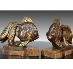 Art deco bookends with fishes. Dinanderie patina