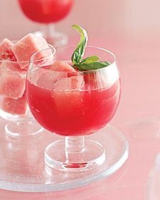"After a stay in the freezer, cubes of watermelon become ""ice"" for this margarita, which gets an herbal edge from basil-infused tequila."