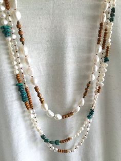 The original pearl and wood mala necklaces by GirlwiththePearl1 on etsy! Love love love this collection!!