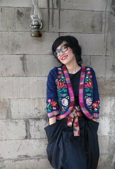 A love affair with batik Indonesia & hungarian embroidery I am wearing Batik Amarillis' Folkloric jacket (a splendid navy twill Hungarian embrodery jacket with Tenun Bali  of Indonesia and Celine glasses