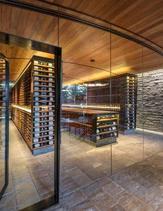 A Sleek Slopeside Cellar Photo by Audrey Hall. A spacious and cleverly engineered wine room takes a traditional Wyoming ski home to a new level. Glass Wine Cellar, Home Wine Cellars, Wine Cellar Design, Caves, Wine Shop Interior, Wine Cellar Basement, Verre Design, Wine House, In Vino Veritas