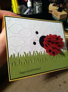 Ladybug made with scallop circle punch (4) folded in half and glued together. 1 inch circle for head. Fiskars grass punch. Small sayings stamp set