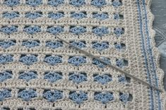 little boy blue (heart) blanket... felt like it took forever with using the 2.25mm hook…  Crocheted baby blanket.