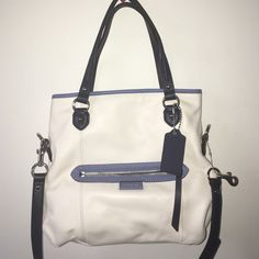 Daisy Spec Mia crossover bag Cute crossover bag.  Never been used NWT.  Cream and blue with silver hardware. Coach Bags Crossbody Bags