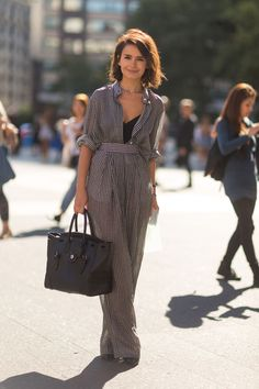 "Two words: Miroslava Duma.  ""If you're petite and normally shy away from full-length jumpsuits, you might just need a waist belt to break up the line. Here, Miroslava Duma totally kills a black-and-white-checked one-piece."""