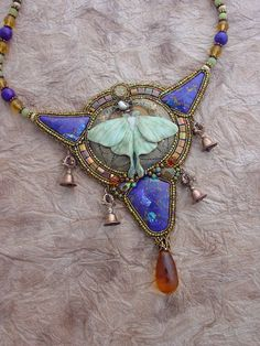 This beautiful necklace has the most beautiful porcelain Luna Moth by Laura Mears. Some lovely cabochons by Gary Wilson and a vintage metal