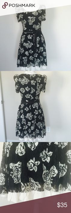 American Rag dress White roses on black. New without tag. 90% nylon, 10% spandex American Rag Dresses Midi