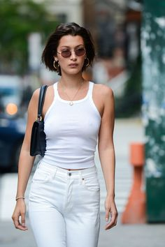 Bella Hadid wearing a white tank top by Re/Done.