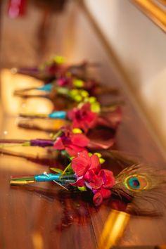 #red #orchid #peacock #groom #groomsmen