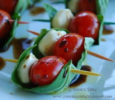 this is such a cool idea.  cherry tomatoes, mozzarella wrapped in a basil leaf and drizzle with vinegar and oil