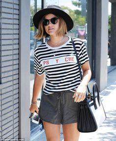 Zebra-like: Wearing a black hat and a shirt decorated with black-and-white zebra stripes, ...