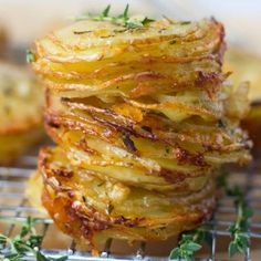 Gruyere and Thyme Stacked Potatoes. Crispy edges and soft gruyere & parmesan centers these stacked potatoes are perfect as a Thanksgiving or anytime! Potato Sides, Potato Side Dishes, Vegetable Dishes, Side Dish Recipes, Vegetable Recipes, Vegetarian Recipes, Cooking Recipes, Cooking Cake, Gourmet Cooking