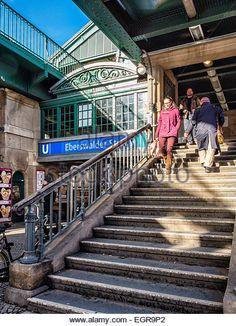 Germany Berlin Eberswalderstraße U-Bahn station entrance, raised green iron railway station on stone columns - Stock Image