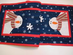 Quilted Christmas winter table runner snowman applique with shimmery snowflakes This item has free shipping to U.S. Small runner measures 11 X 31 in. Appliqued Snowmen on each end of this red, bue and white winter table runner with shiny stars in the sky . The snowmen are made from a
