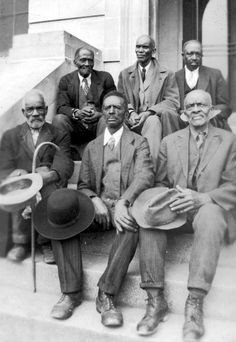 African American ex-slaves sitting, original caption 'Attendants at Old Slave Day', Southern Pines, North Carolina, April 8, 1937.