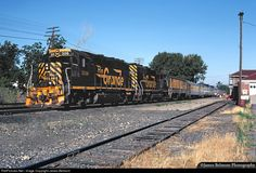 RailPictures.Net Photo: DRGW 3116 Denver & Rio Grande Western Railroad EMD GP40-2 at Provo, Utah by James Belmont | By the early 1980s, the Rio Grande Zephyr was losing money. To reduce costs, the D&RGW was looking for ways to economize. By the summer of 1982, they tested alternative power arrangements to reduce fuel consumption. One GP40-2 and one F9B were tested with mixed results. Two GP40-2s, No. 3116 and 3119 were evaluated on July 15-16th with no F9s at all.
