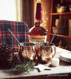 Winter rustic vignette, copper mugs, maker's mark.