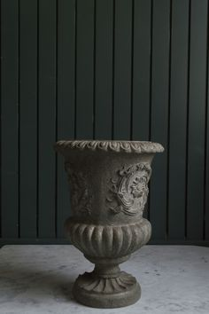 Our smaller grey urn also available for rental with a similar pedestal.