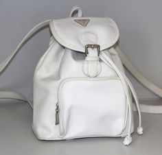 A white Guess mini-backpack is basically the epitome of the '90s. | The 26 Ugliest '90s Backpacks To Ever Meet Your Eyes