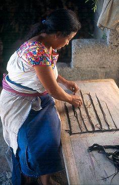 Otomi woman making amate bark paper in San Pablito, Puebla, Mexico