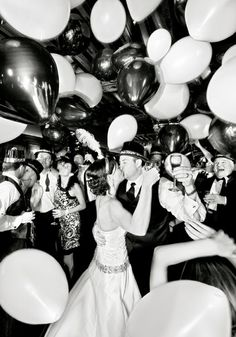 Ring in the new year at your wedding with balloons and a kiss! | Brides.com