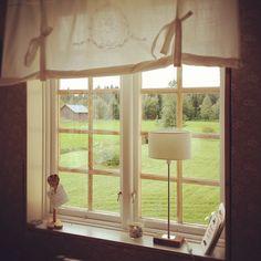 Calming Nature through a beautiful Swedish window