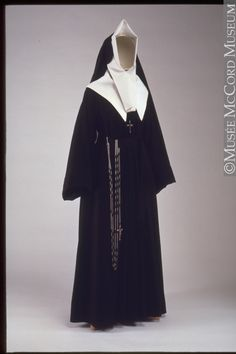 This habit was worn by a Sister of the Congregation of Notre-Dame. The Congregation was founded in Montreal in 1652 by Marguerite Bourgeoys (1620-1700), who had come from France to the small settlement of Ville-Marie to establish a school. At that time there were few children to teach, so the Sisters helped the sick and needy. From this modest beginning, the Congregation of Notre-Dame grew into a well-respected teaching order.