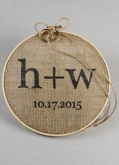 "Burlap is a beautifully rustic fabric to add to your wedding day. Personalize this ring bearer embroidery hoop with your initials and wedding date.  Finished with a jute cord tied in a bow, this hoop will be the right piece for your rustic wedding. Rings not included. Features and Facts:  Size: 7 inches round  Hoop is made of wood  Center fabric made of burlap  Initials are lowercase   ""+"" in between initials is standard View Font"